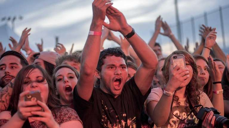 Attendees cheer as Circa Survive performs its set,