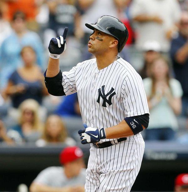 Carlos Beltran of the Yankees celebrates his second-inning