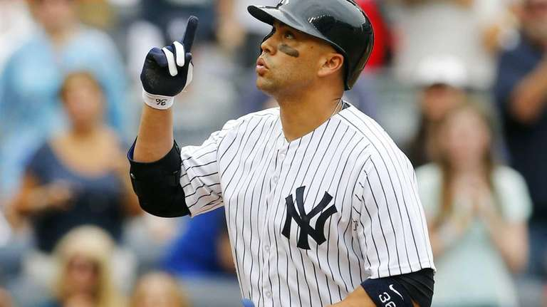 Carlos Beltran of the Yankees celebrates his second-inning