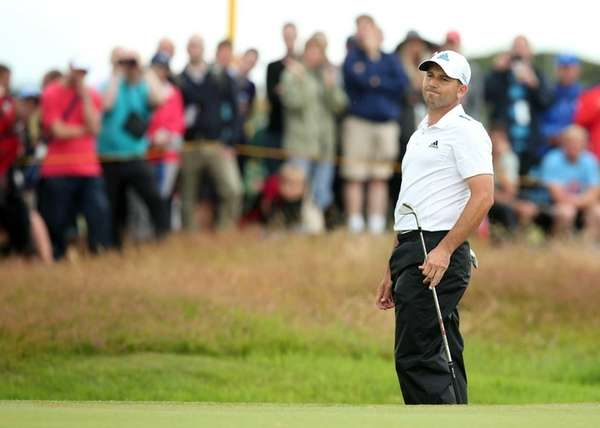 Sergio Garcia reacts on the 17th green on