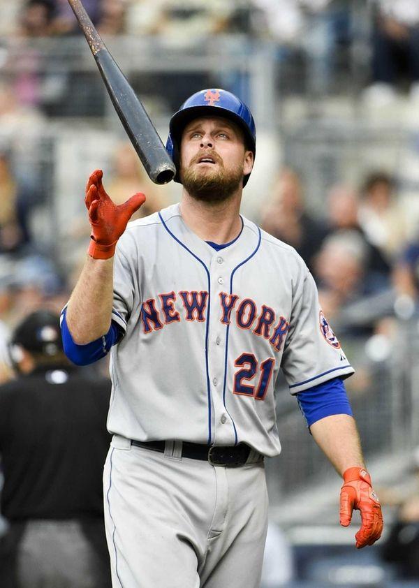 Lucas Duda of the Mets tosses hit bat