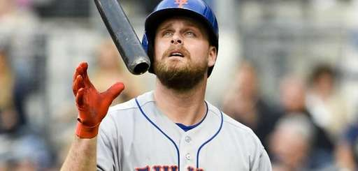 Lucas Duda of the Mets tosses hit bat