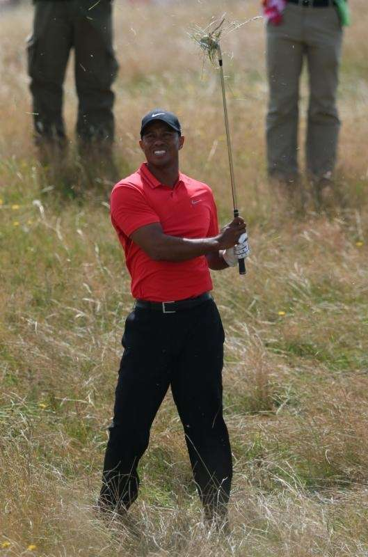 Tiger Woods plays out of the rough on