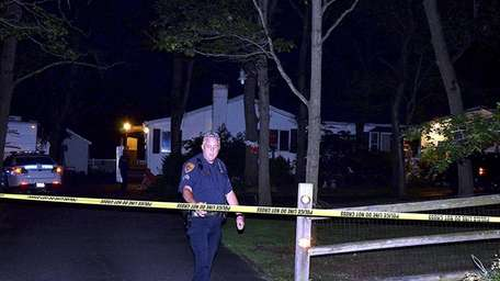 Suffolk County police respond to a home on