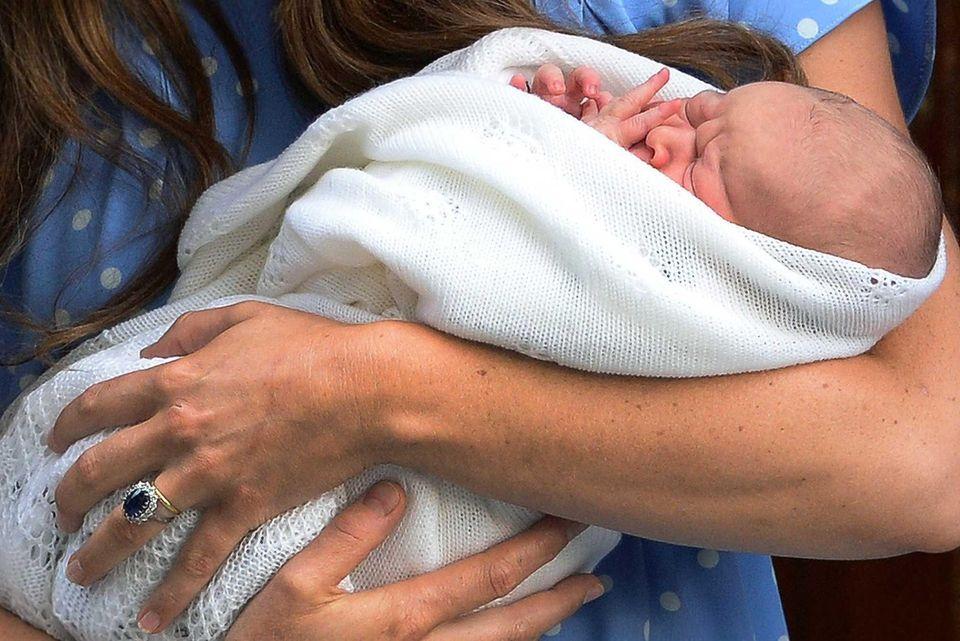 Catherine, Duchess of Cambridge, holds her newborn baby