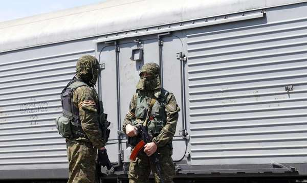 Armed rebels guard the train's refrigerated coaches that