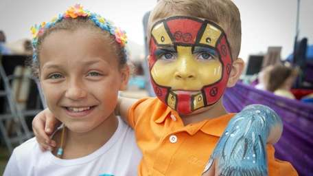 Yaphank residents Sophie, 9, and Roman, 3, show