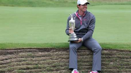 Northern Ireland's Rory McIlroy holds the Claret Jug