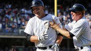 Brian McCann of the Yankees celebrates his ninth-inning,