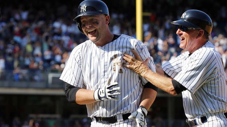 Brian McCann of the Yankees celebrates his ninth-inning,