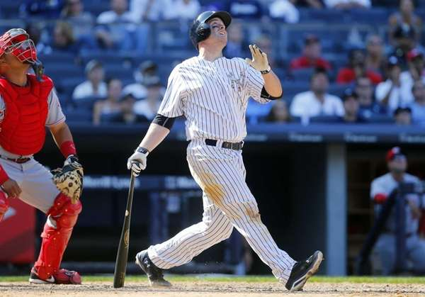 Brian McCann of the Yankees follows through on