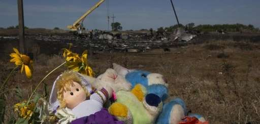 Toys and flowers are placed at the crash
