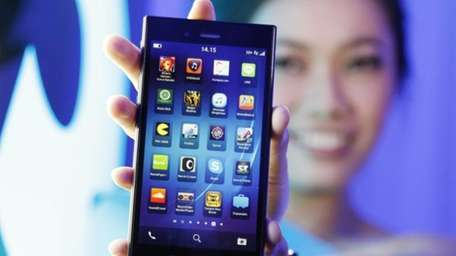 A Blackberry Z3 smartphone is shown by a