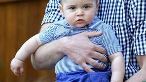 Prince William, Duke of Cambridge holds Prince George