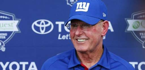 Tom Coughlin speaks to the media after conditioning