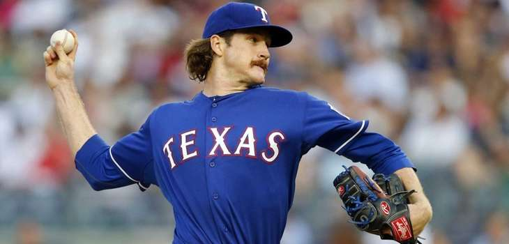 Miles Mikolas of the Texas Rangers pitches against