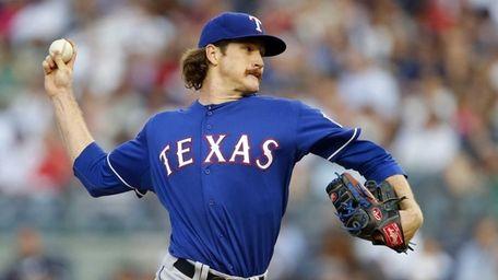 Miles Mikolas of the Texas Rangers pitches against