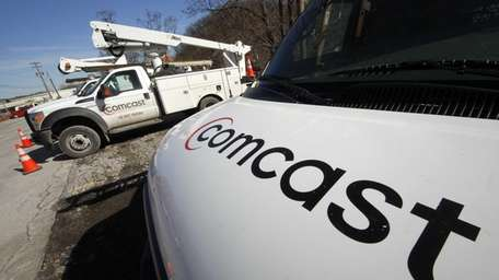 Comcast installation trucks in Pittsburgh on Feb. 15,