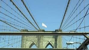 A white flag flutters over the Brooklyn Bridge