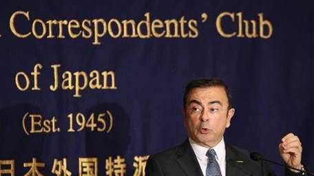 Nissan chief executive Carlos Ghosn speaks during a