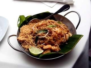 Pad thai with shrimp is served in a