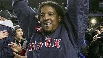 Boston Red Sox pitcher Pedro Martinez celebrates after