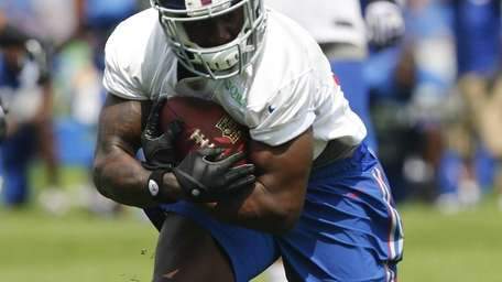 David Wilson of the Giants runs drills during