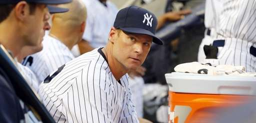 Chase Headley of the Yankees looks on from