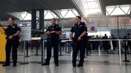 Heavily armed police at JFK Airport's terminal 4,