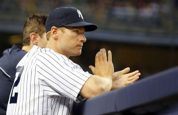 Chase Headley of the Yankees cheers on his