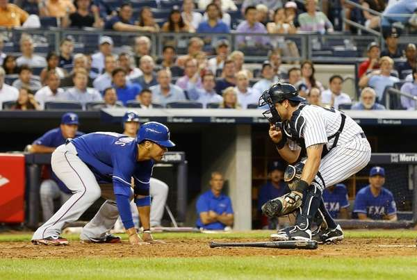 Francisco Cervelli of the Yankees tags out Robinson
