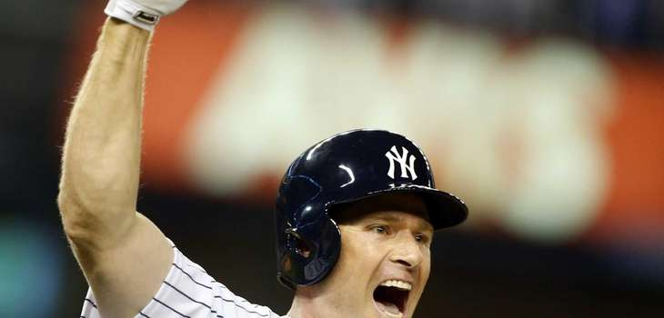 Chase Headley of the Yankees celebrates his 14th-inning,
