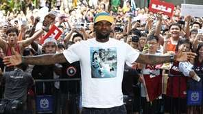 NBA star LeBron James poses with his fans