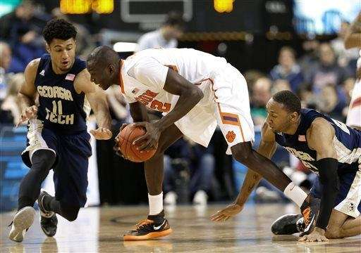 Clemson's Ibrahim Djambo, center, tries to keep the