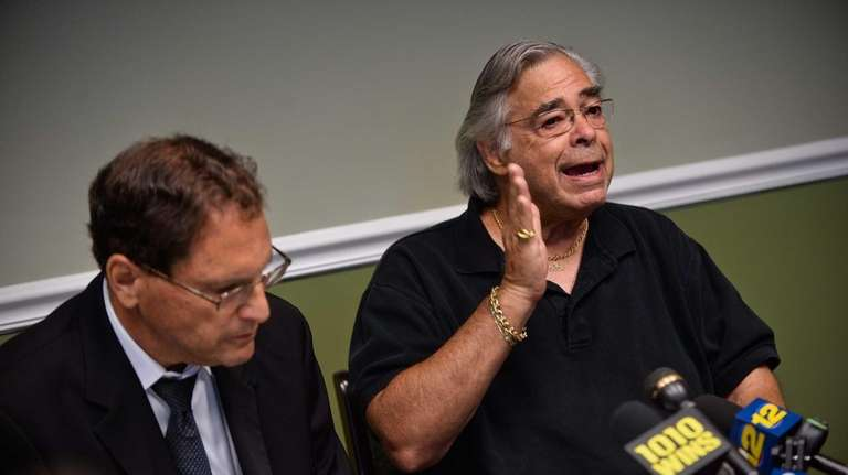 Hauppauge resident Stephen D'Giff, right, with attorney Kenneth
