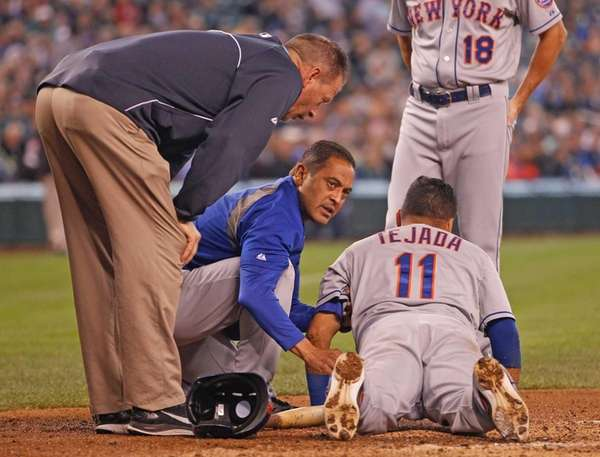 Ruben Tejada of the Mets is tended to