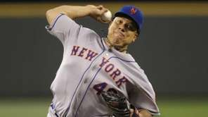 Mets starting pitcher Bartolo Colon throws against the