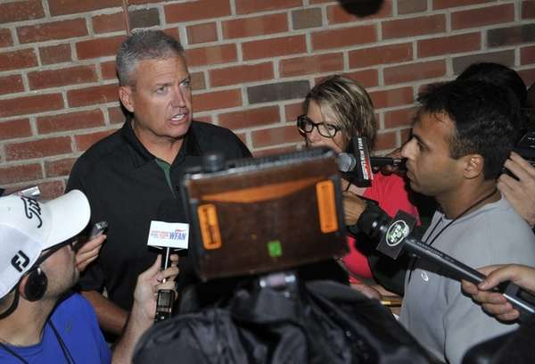 Jets head coach Rex Ryan talks with reporters