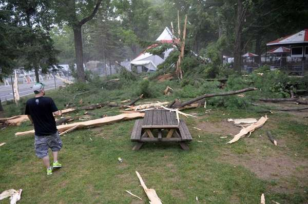 People look at damage moments after lightning struck
