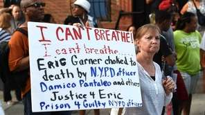 Demonstrators gather outside the funeral service for Eric