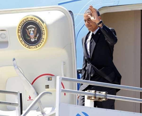 President Barack Obama waves to supporters as he