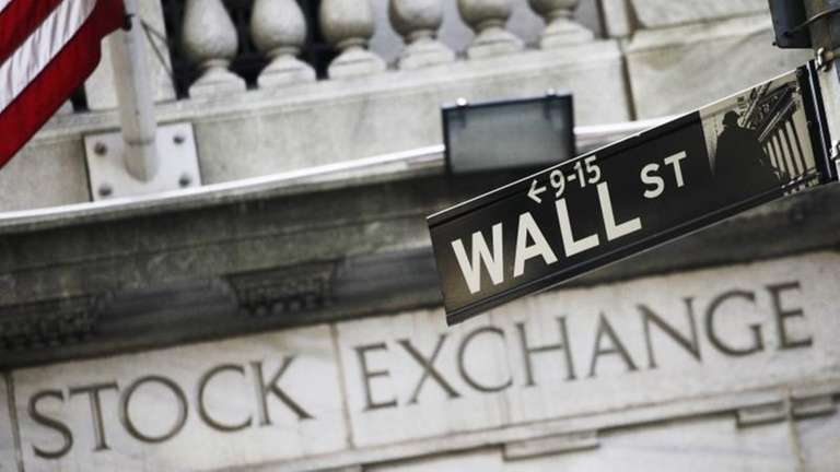 A street sign for Wall Street outside the