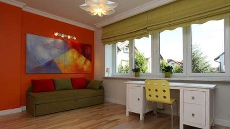 Ideal for large windows, Roman shades add style