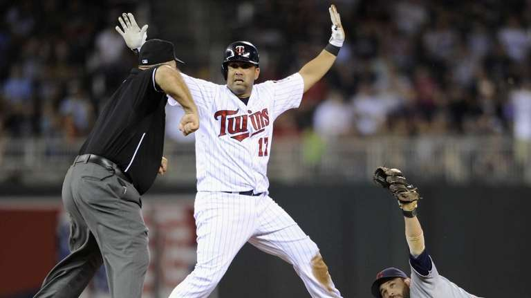 Kendrys Morales of the Minnesota Twins reacts as