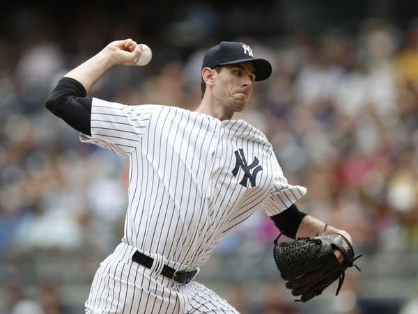 Yankees starting pitcher Brandon McCarthy pitches in the