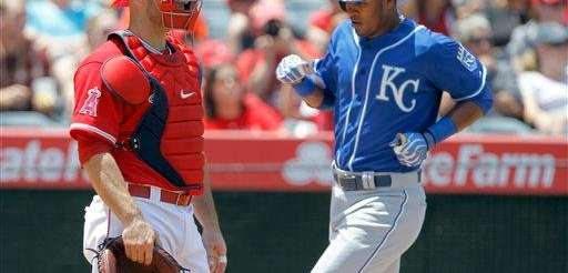 The Kansas City Royals' Jimmy Paredes scores behind