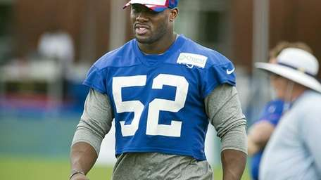 Giants linebacker Jon Beason looks on during practice