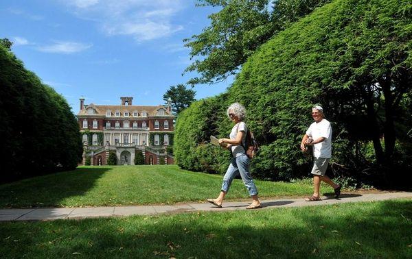 Vistors to Old Westbury Gardens stroll through the