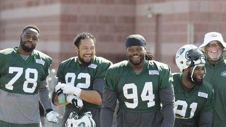Jets defensive linemen Leger Douzable, Tevita Finau, Damon