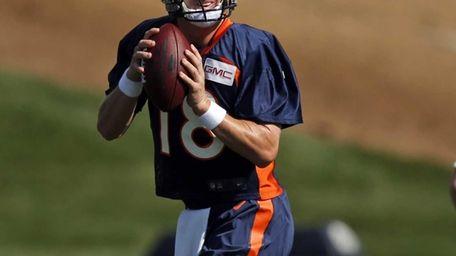 Denver Broncos quarterback Peyton manning runs a drill
